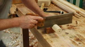 sawing a shoulder for the rectangular tenon
