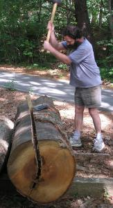 driving a wooden wedge