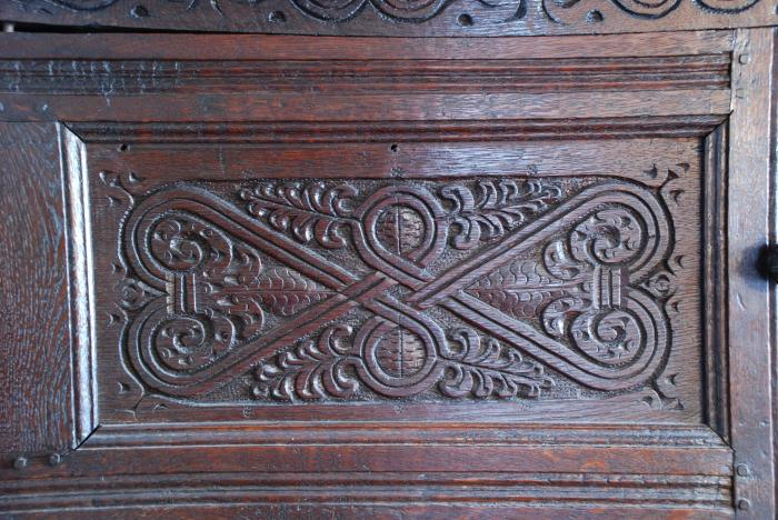 torn-up moldings on cupboard door panel, 1691