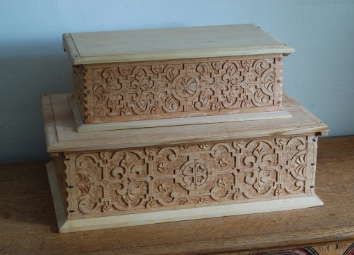"""strapwork"" patterns on box fronts"