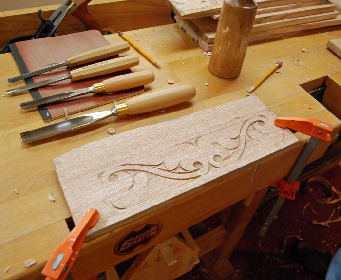 student carving scroll